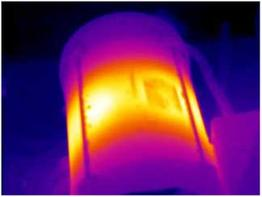 This infrared image shows an overheating electric motor found during a home inspection by Florida Certified Home Inspections.